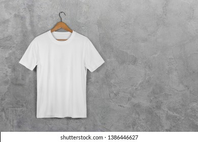 White Blank Cotton Tshirt Hanging Center Gray Concrete Empty Wall Background with clipping path