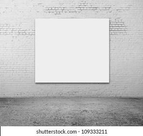 white blank frame on a brick wall