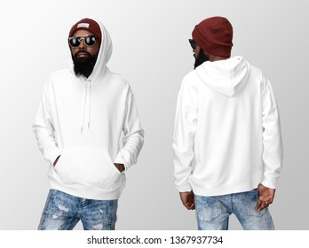 White blank hoodie on a young african american man in jeans, isolated on a white studio background, front and back view mockup of white hoodie with place for your logo or design