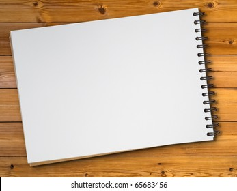 White blank page sketch book on wood table
