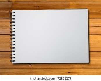 White blank page sketch book on wood table horizontal