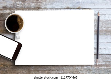 White blank paper notepad with pencil,smartphone and coffee on brown wood table background.using wallpaper for education.Take note of the product for book with paper and concept, object or copy space