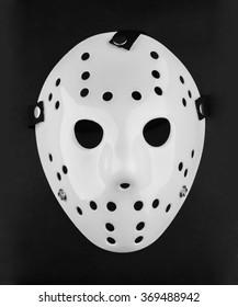 White Blank Plastic Hockey Mask On Reflective Surface
