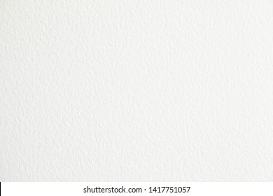 White blank sheet of paper with rough surface texture background.