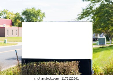 White blank sign on suburban street close up. Advertisement with clipping path and copy space.