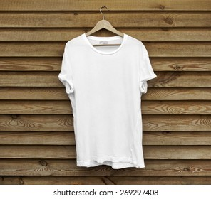 White blank t-shirt on wood wall