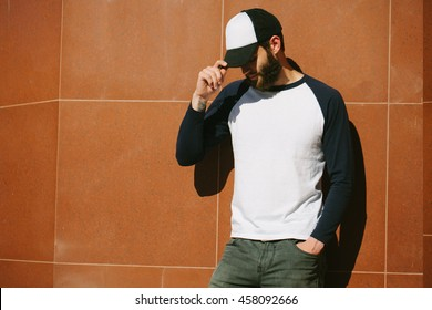 white blank t-shirt with space for your logo on a hipster man with a beard
