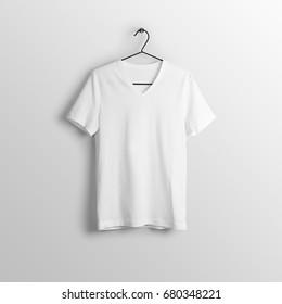 White blank v-neck t-shirt mockup on hanger, hanging against empty wall background.
