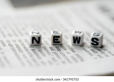 White blocks with the text, NEWS, on the newspaper