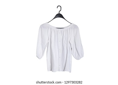 White blouse hanging on a hanger isolate on white background
