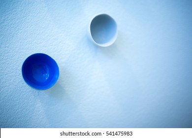 White and blue cups