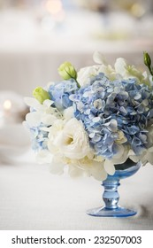 white and blue flower in blue vase