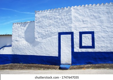 white and blue house in portuguese village