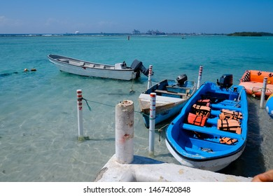 White and blue motorboats in the blue sea bay scene. Motorboat with life vests. touristic concept
