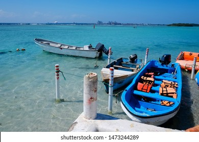 White and blue motorboats in the blue sea bay scene. Motorboat with life vests. tourism concept