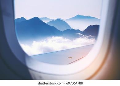 White blue night sky as seen through window of an aircraft.