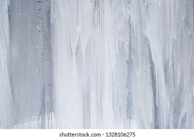 White and blue paint dripping on a surface, abstract background
