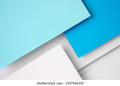 White and blue paper concept background with shadow and copy space. Geometric layer design.