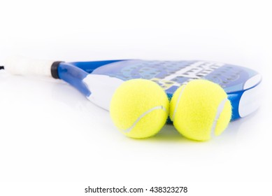 White and blue racket paddle with two balls on white background