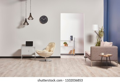 white and blue room grey sofa and grey cabinet with laptop style brown lamp black clock on the wall.