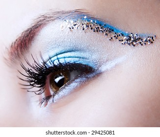 White and blue with silver sparkle make-up
