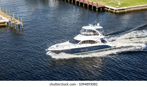 White and Blue Yacht Motoring the Intracoastal