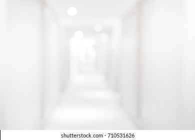 White Blurred Hallway Background Banner . Bokeh White Christmas shiny blurred lights ,Christmas Background or Medical background