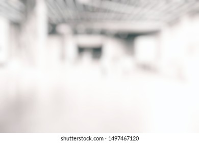 White Blurred Interior of Hallway Background with Cool Bokeh.