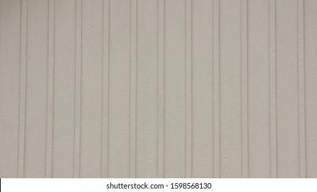 White Board and Batten exterior woodgrain vinyl siding.