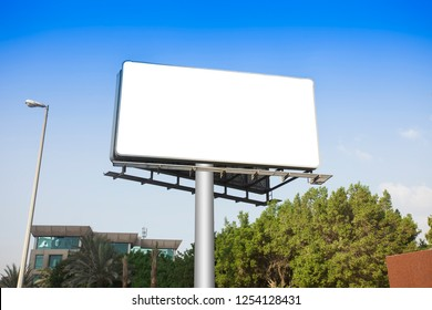 white board or billboard sign on clear blue sky background