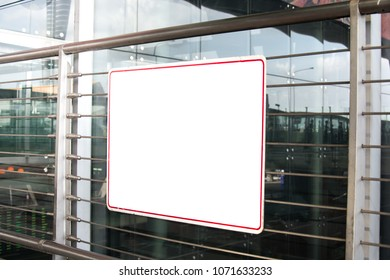 white board on steel tube pole of building