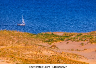 White Boat in Nida, Lithuania. Nida - Curonian Spit and Curonian Lagoon, Nida, Klaipeda, Lithuania. Baltic Dunes. Unesco heritage. Nida is located on the Curonian Spit