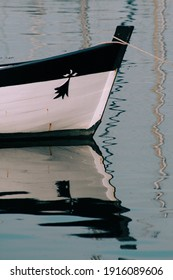 white boat with reflection in the water mirror