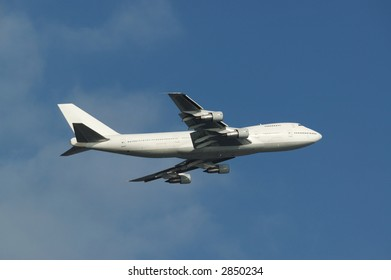 a white bodied boeing 747 just departed