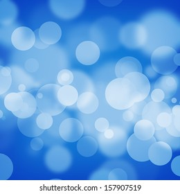 White bokeh on blue background