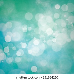 White bokeh on blue and green grunge background