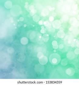 White bokeh on blue green watercolor background