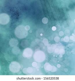 White bokeh on grungy blue background with subtle masking tape embellishments