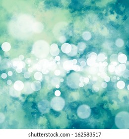 White bokeh on grungy green and teal background