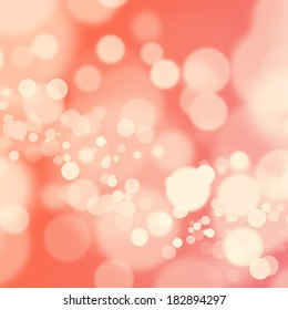 White bokeh on soft pink gradient background