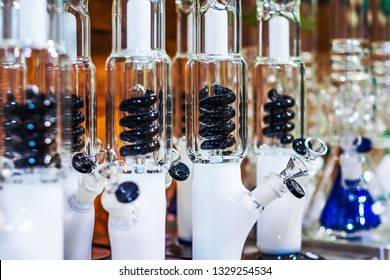 white bongs with black spiral percolator on blurred background