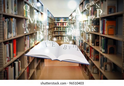 A white book is floating with sparkles and letters in a library isle. Use it for a literature or education concept.