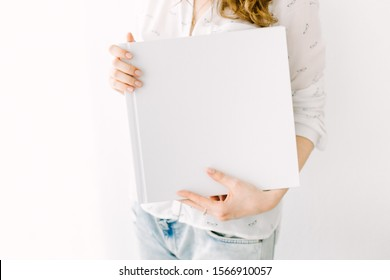 White book mockup. Square empty book. Album with clean pages in hands of woman. Clean book cover mockup