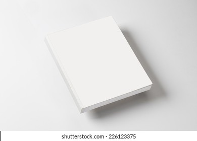 white book on a white table with natural shadow
