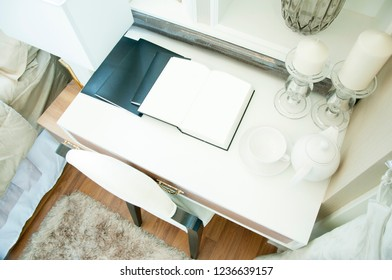 white book page open on the white table in luxury bedroom.