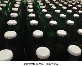 White bottle caps. Many white bottle caps. Beer bottle white caps. Bottle heads.