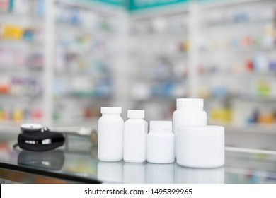 white bottle medicine on counter and shelf medicine in pharmacy  background