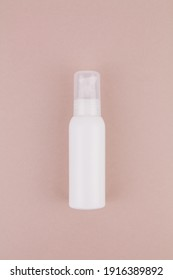 a white bottle without an inscription on a light background for perfume or antiseptic gel
