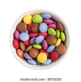 a white bowl filled with candy against a white background