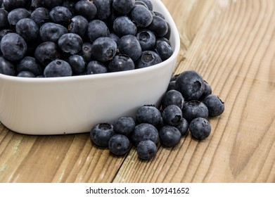 White bowl filled with fresh Blueberries